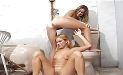 Hot lesbian girls pee on each other