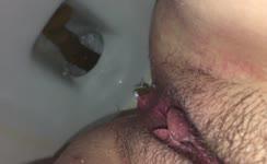Close up of sexy babe shitting