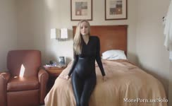 Beautiful blonde wearing a black catsuit