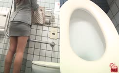 She shits over toilet