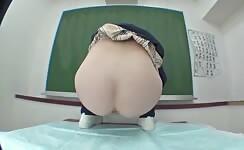 Asian girls huge poop on classroom table