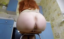 Redhead babe shits on kitchen floor